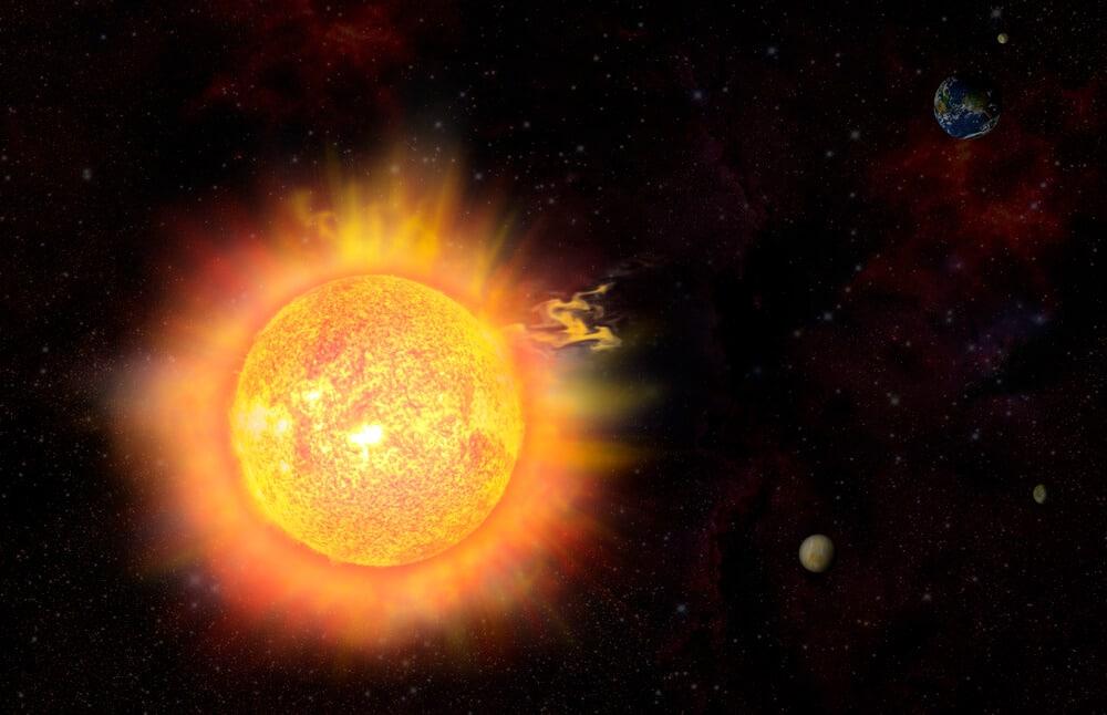 Slnko v slnečnej búrke vo vesmíre a vzdialená zem v tieni